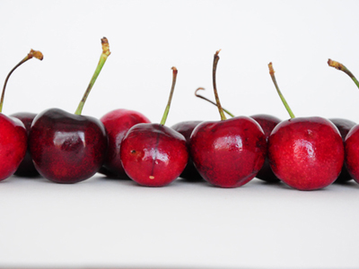 A photo of cherries taken with a lightbox.