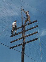 men_working_on_telephone_lines